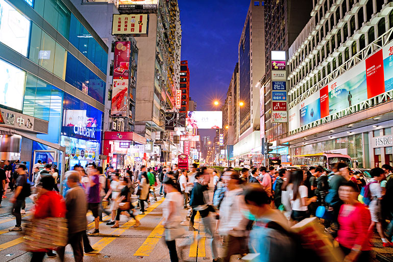 A busy street scene in Kowloon, Hong Kong.